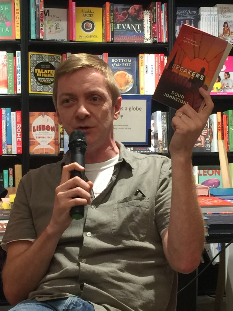 Photo of Doug Johnstone holding his book, Breakers