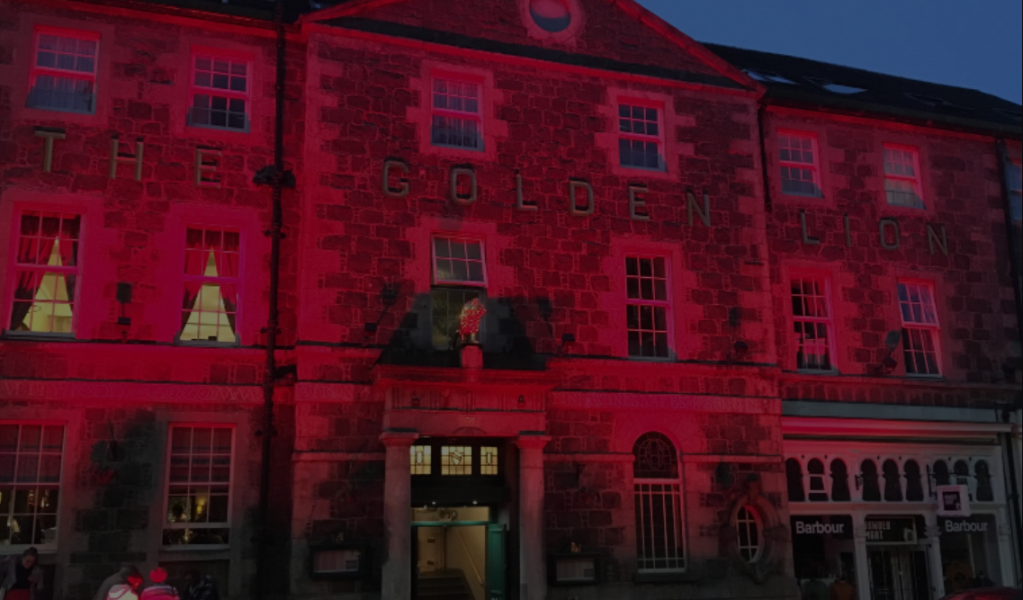 Bloody Scotland HQ at the Golden Lion, lit up by red floodlights