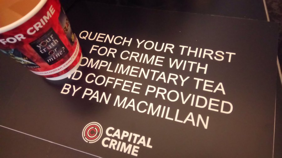 Photo of coffee cup with Pan MacMillan sponsorship.